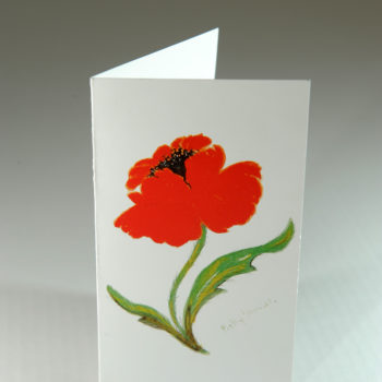 Greeting card featuring a hand painted poppy on the front cover