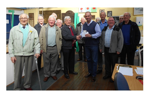 Tulliallan & Kincardine Men's Club presenting cheque to the Manager of the Lady Haig's Poppy Factory
