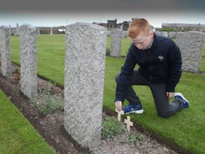 School Pupil Plants A Remembrance Cross during a School Battlefield Tour. Crosses are available all year round from Lady Haig's Poppy Factory, Edinburgh, EH7 4HJ